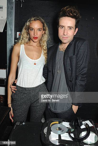 Phoebe Collings Jones and Nick Grimshaw attend the Tiger of Sweden store opening after party at Le Baron on October 3 2013 in London England