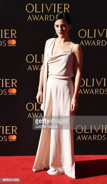 Phoebe Fox poses on the red carpet upon arrival to attend the 2017 Laurence Olivier Awards in London on April 9 2017 / AFP PHOTO / JUSTIN TALLIS