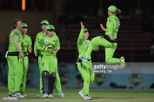 Phoebe Litchfield of the Thunder celebrates with team mates after running out Georgia Voll of the Heat during the Women's Big Bash League WBBL Semi...