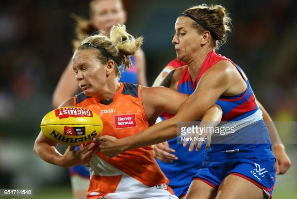 Phoebe McWilliams of the Giants is tackled by Hannah Scott of the Bulldogs during the round seven AFL Women's match between the Greater Western...