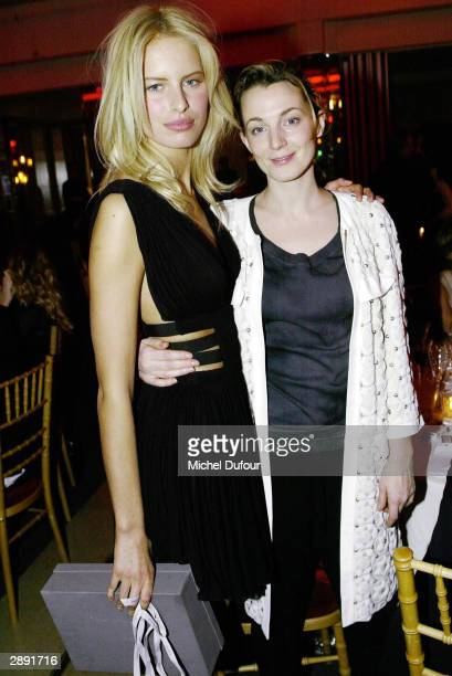 Phoebe Philo with top model Karolina attend Aids Gala Fashion Show during Paris Fashion Week on January 21 2004 in Paris France