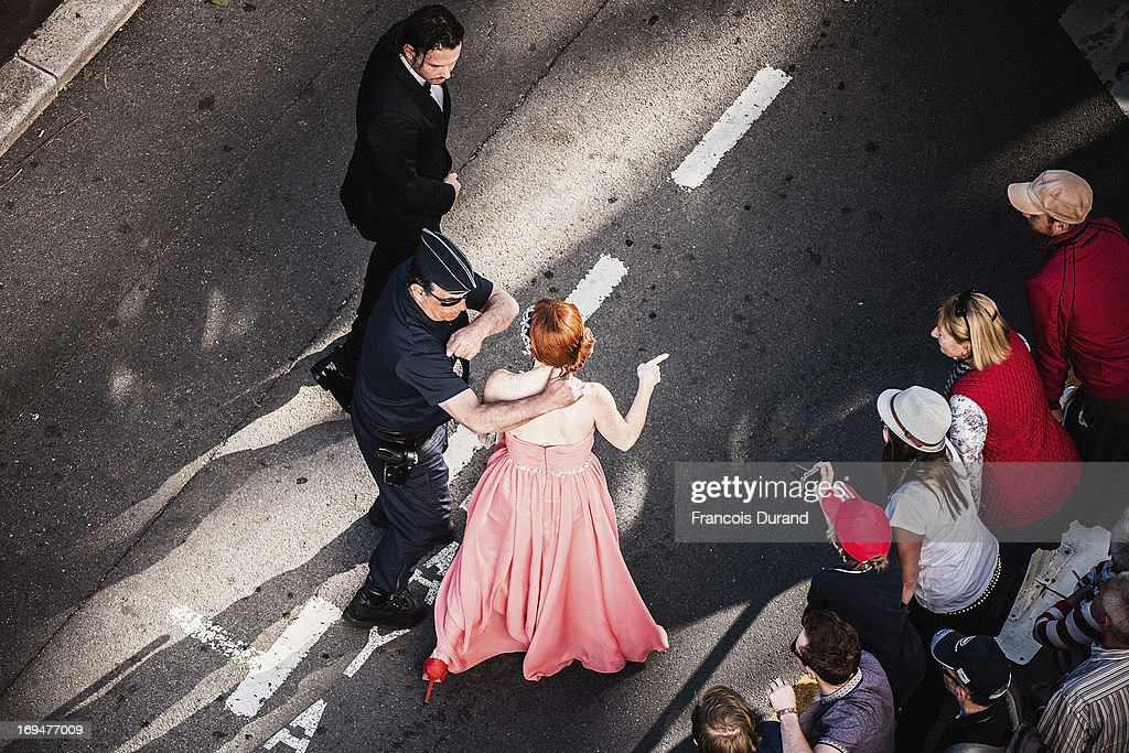 Phoebe Price is approached by a police officer as she arrives at 'La Venus A La Fourrure' premiere during The 66th Annual Cannes Film Festival on May 25, 2013 in Cannes, France.