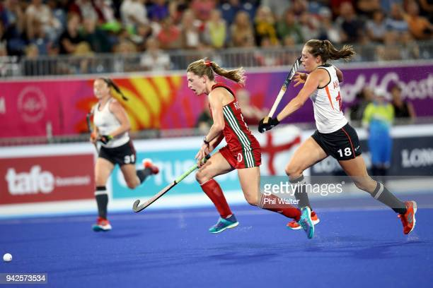 Phoebe Richards of Wales and Giselle Ansley of England contest the ball during their Womens Hockey match between England and Wales on day two of the...