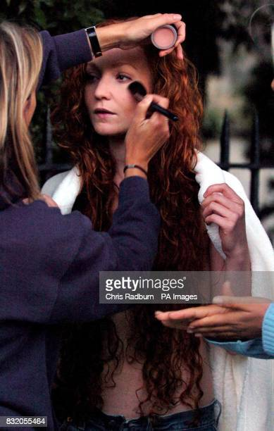 Phoebe Thomas from London has her make up adjusted before she rides a white horse posing as a modern day Lady Godiva in Oxford town centre whilst...
