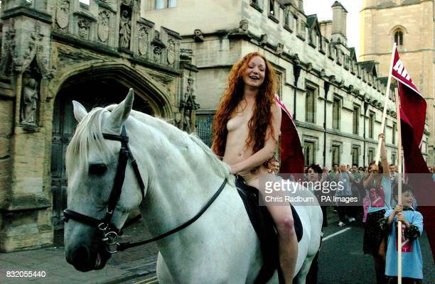 Phoebe Thomas from London rides a white horse posing as a modern day Lady Godiva as she crosses Magdalene Bridge in Oxford town centre whilst filming...