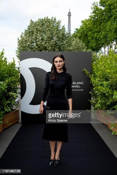 Phoebe Tonkin attends the Noir et Blanc de Chanel Fall/Winter 2019 Makeup Collection Yachts De Paris on July 11 2019 in Paris France