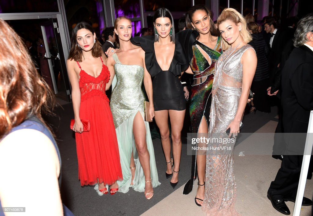 Phoebe Tonkin, Rosie Huntington-Whiteley, Kendall Jenner, Joan Smalls and Hailey Baldwin attend the 2018 Vanity Fair Oscar Party hosted by Radhika Jones at Wallis Annenberg Center for the Performing Arts on March 4, 2018 in Beverly Hills, California.
