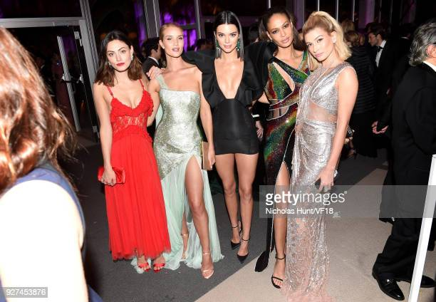 Phoebe Tonkin Rosie HuntingtonWhiteley Kendall Jenner Joan Smalls and Hailey Baldwin attend the 2018 Vanity Fair Oscar Party hosted by Radhika Jones...