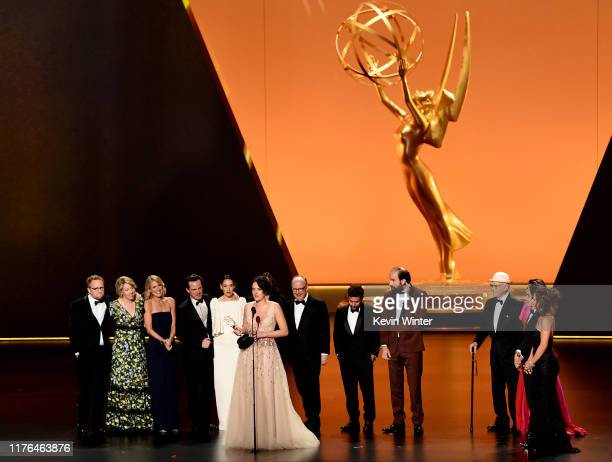 Phoebe Waller-Bridge and fellow cast and crew members of 'Fleabag' accept the Outstanding Comedy Series award onstage during the 71st Emmy Awards at...