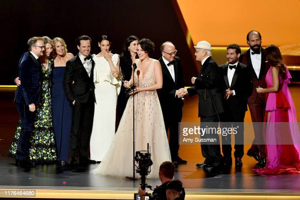 Phoebe WallerBridge and fellow cast and crew members of 'Fleabag' accept the Outstanding Comedy Series award from Norman Lear and Marisa Tomei...