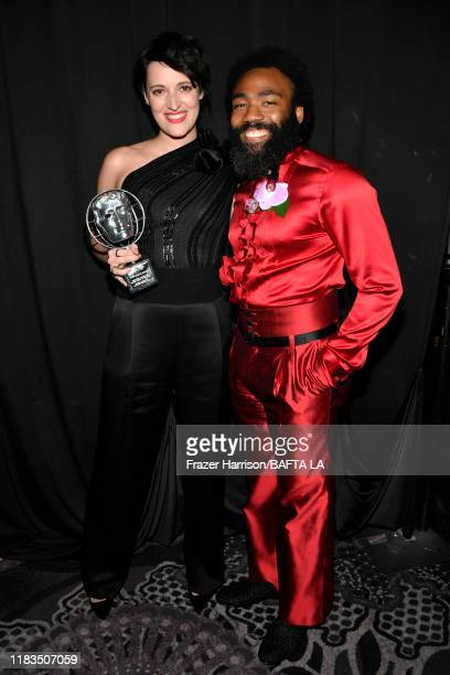 Phoebe Waller-Bridge, recipient of the Britannia Award for British Artist of the Year, and Donald Glover pose during the 2019 British Academy...