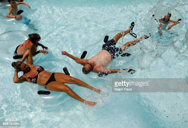 Phoenix area residents float on intertubes as they try to find some relief from the heat at the WetNWild Water Park on June 20 2017 in Phoenix...