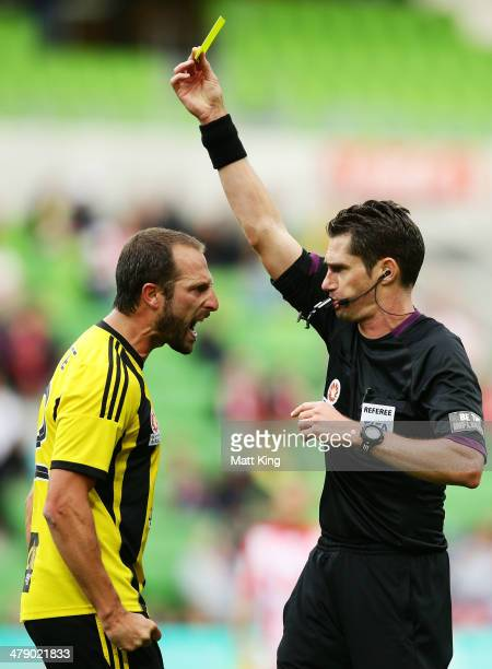Phoenix captain Andrew Durante argues with referee Ben Williams and is given a yellow card during the round 23 ALeague match between Melbourne Heart...