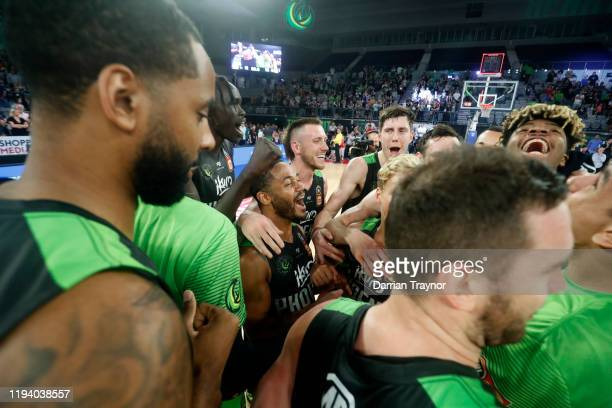 Phoenix celebrate their overtime win during the round 11 NBL match between the South East Melbourne Phoenix and the Cairns Taipans at Melbourne Arena...