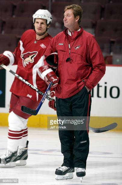 Phoenix Coyote's head coach Wayne Gretzky looks on as Mike Ricci skates by during their game day skate at General Motors Place on October 5 2005 in...