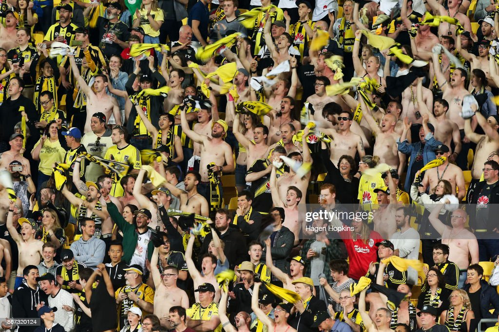 Phoenix fans take their shirts off at the 80 minute mark during the round four A-League match between the Wellington Phoenix and the Brisbane Roar at Westpac Stadium on October 28, 2017 in Wellington, New Zealand.