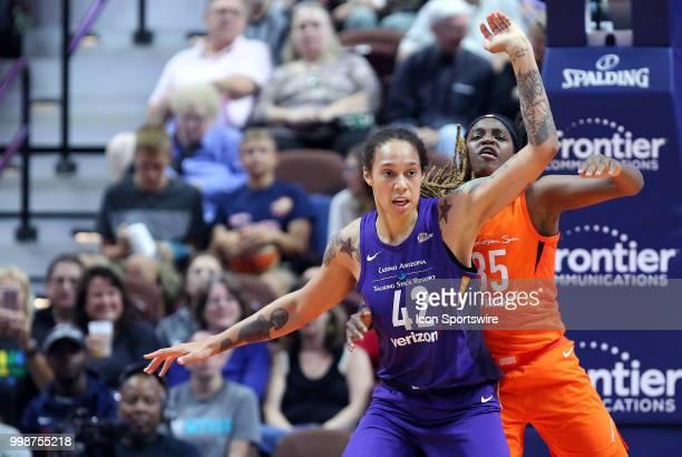 Phoenix Mercury center Brittney Griner and Connecticut Sun forward Jonquel Jones battle for position during a WNBA game between Phoenix Mercury and...