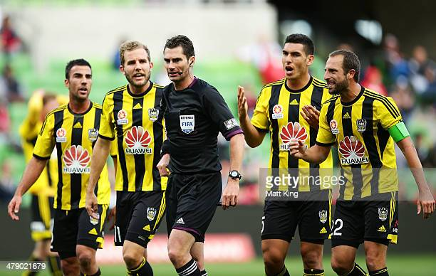 Phoenix players argue with referee Ben Williams after he awarded a penalty to the Heart for a foul on Harry Kewell during the round 23 ALeague match...