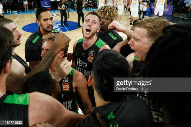 Phoenix players celebrate after the round two NBL match between the South East Melbourne Phoenix and the Brisbane Bullets at Melbourne Arena on...