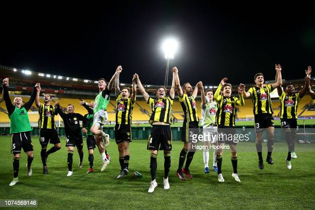 Phoenix players celebrate at the final whistle during the round nine ALeague match between the Wellington Phoenix and the Brisbane Roar at Westpac...