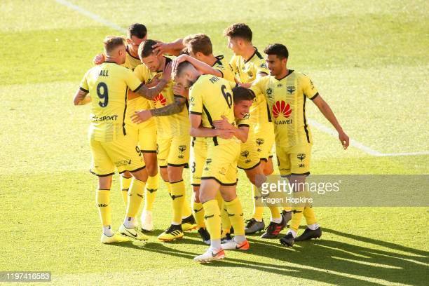 Phoenix players celebrate the goal of Gary Hooper during the round 13 A-League match between the Wellington Phoenix and the Central Coast Mariners at...