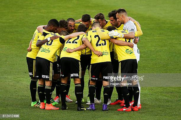 Phoenix players form a huddle during the round 21 ALeague match between the Wellington Phoenix and Melbourne City FC at Westpac Stadium on February...