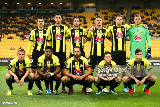 Phoenix players pose for a team photo during the round 15 ALeague match between the Wellington Phoenix and Melbourne Victory at Westpac Stadium on...
