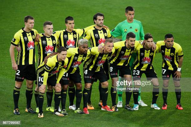Phoenix players pose for a team photo during the round four ALeague match between the Wellington Phoenix and the Brisbane Roar at Westpac Stadium on...