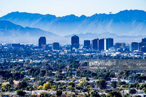 phoenix skyline and the mountains beyond - phoenix arizona stock photos and pictures