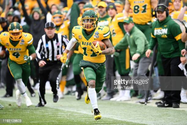 Phoenix Sproles of the North Dakota State Bison races for a touchdown against the James Madison Dukes during the Division I FCS Football Championship...