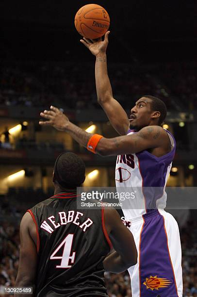Phoenix Suns' Amar'e Stoudemire right plays the ball against Chris Webber left of Philadelphia 76ers during a NBA Live Tour friendly basketball match...