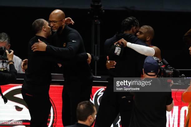 Phoenix Suns coach Monty Williams, LA Clippers coach Tyronn Lue hug and LA Clippers forward Kawhi Leonard and Phoenix Suns guard Chris Paul hug...