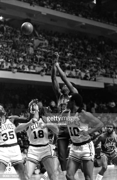 Phoenix Suns' Curtis Perry shoots over from left Boston Celtics' Paul Silas Dave Cowens and Jo Jo White during Game 2 of the 1976 NBA Finals at the...