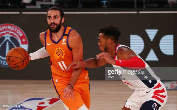 Phoenix Suns guard Ricky Rubio is defended by Washington Wizards forward Troy Brown Jr #6 in the second half of a NBA basketball game at ESPN Wide...