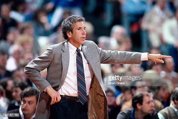 Phoenix Suns head coach John Macleod points against the Portland Trailblazers at the Veterans Memorial Coliseum in Portland Oregon circa 1987 NOTE TO...