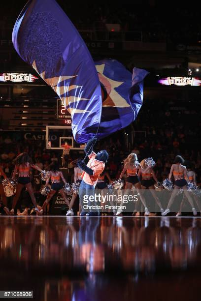 Phoenix Suns mascot 'The Gorilla' waves a team flag before the NBA game against the Brooklyn Nets at Talking Stick Resort Arena on November 6 2017 in...
