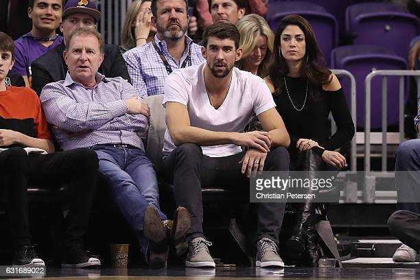 Phoenix Suns owner Robert Sarver USA olympic swimmer Michael Phelps and wife Nicole Johnson attend the NBA game against the Cleveland Cavaliers at...