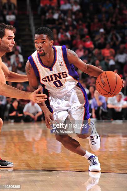 Phoenix Suns point guard Aaron Brooks brings the ball up court during the game against the Toronto Raptors March 23 2011 at US Airways Center in...
