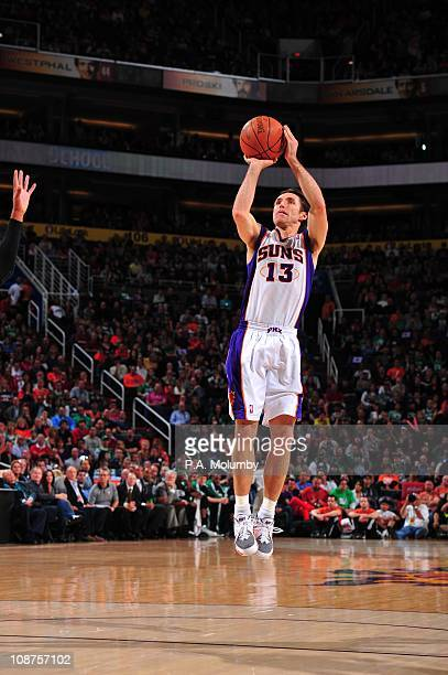 Phoenix Suns point guard Steve Nash goes for a jump shot during the game against the Boston Celtics on January 28 2011 at US Airways Center in...