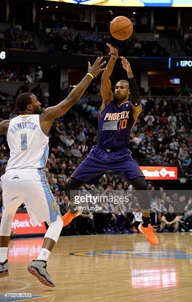 Phoenix Suns shooting guard Leandro Barbosa makes a pass over Denver Nuggets small forward Jordan Hamilton during the fourth quarter February 18 2014...