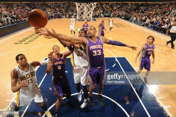 Phoenix Suns small forward Grant Hill gains control of the ball from Indiana Pacers center Roy Hibbert during the game against the Indiana Pacers on...