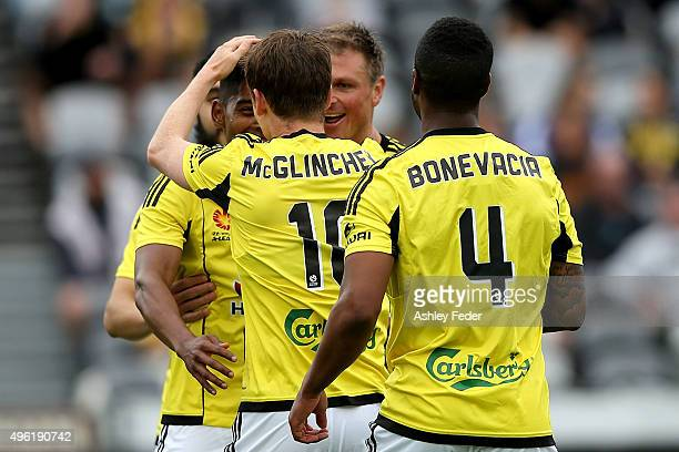 Phoenix team mates celebrate a goal from Michael McGilnchey during the round five A-League match between the Central Coast Mariners and the...