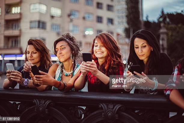Phone addicted girls texting in the city