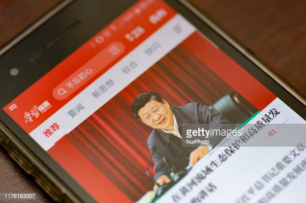 """Phone app called """"Xuexi Qiangguo"""" or """"Study to make China strong"""" displaying a photo of China's President Xi Jinping is taken on..."""