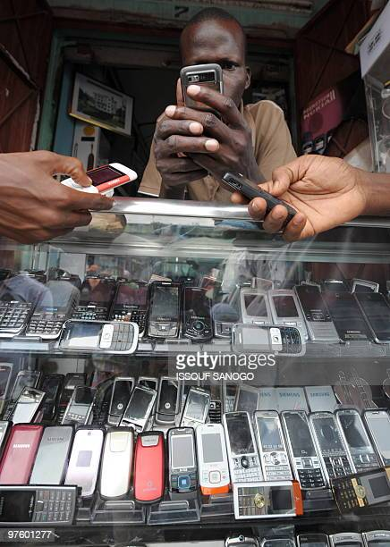 Phone are displayed in a black market mobile phone shop at the Adjame market in Abidjan on June 23 2009 The African market for mobile telephones has...