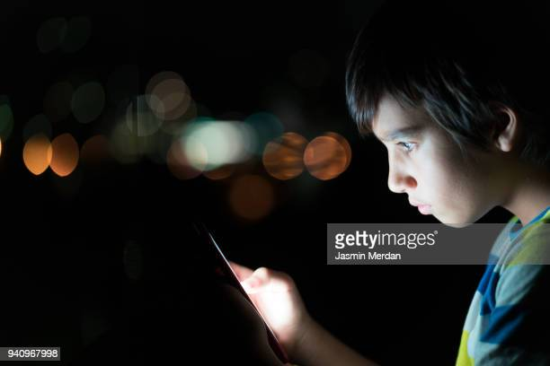 phone as source of light - online bullying stock pictures, royalty-free photos & images