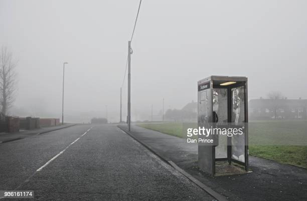phone box along roadside, houghton-le-spring, sunderland, uk - telephone booth stock pictures, royalty-free photos & images