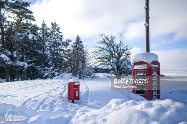 Phone box and post box are seen covered in snow on February 8, 2021 in Cabrach, United Kingdom. Heavy snow in Scotland and South East England over...