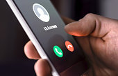 Phone call from unknown number late at night. Scam, fraud or phishing with smartphone concept. Prank caller, scammer or stranger. Man answering to incoming call.