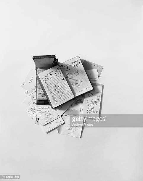 Phone diary with business card against white background